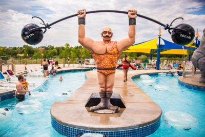 Clown Around water pool, strong man circus figure, big top, water world