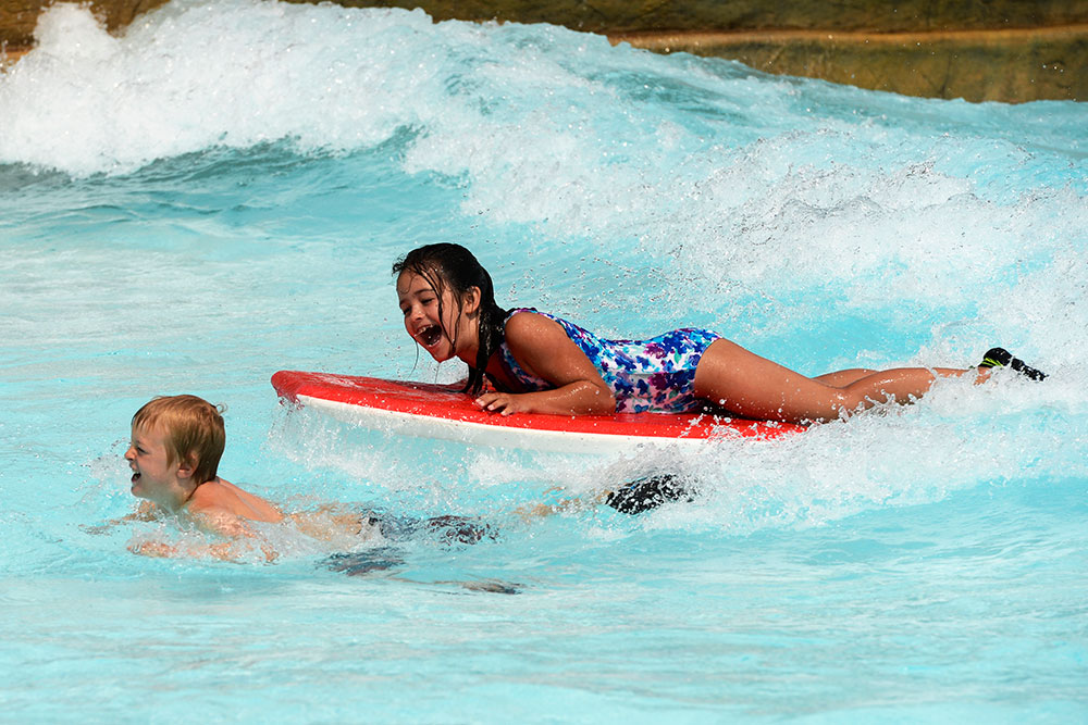 Girl on water board at cowabunga beach, Water World