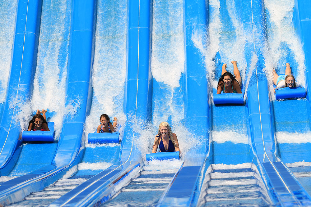 Five girls sliding at Glacier Run, Water World