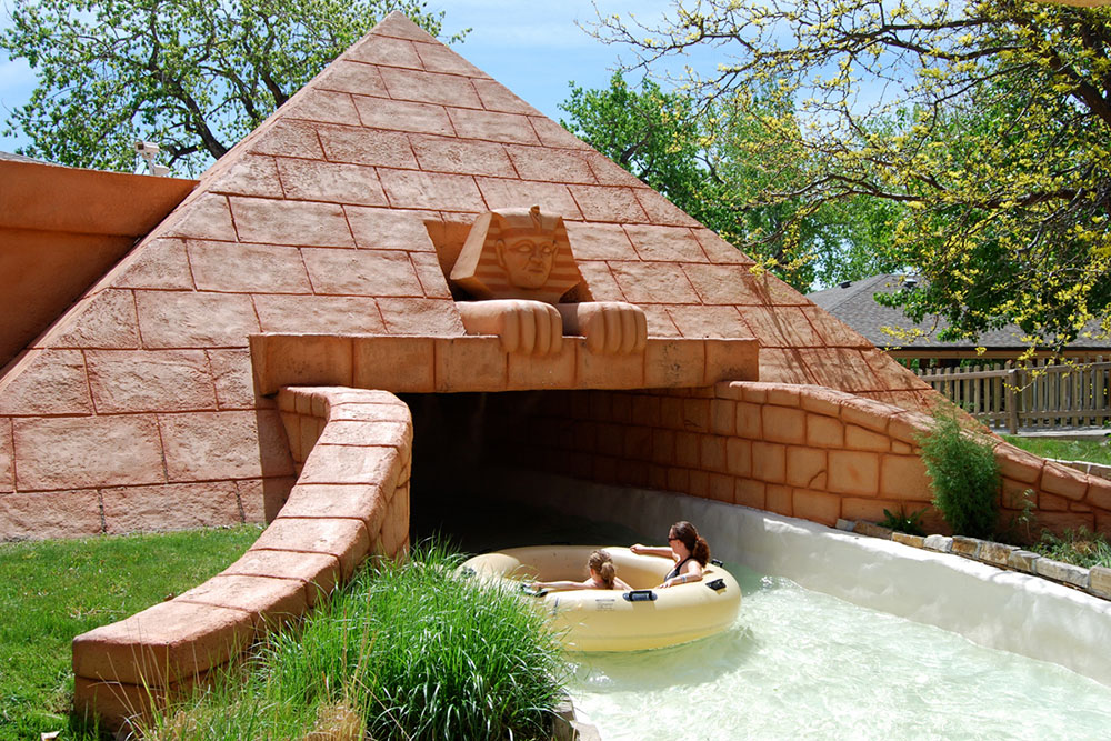 Lost River of the Pharaoh's attraction entrance, mother and daughter on water tube, Pyramid, Egyptian style water ride