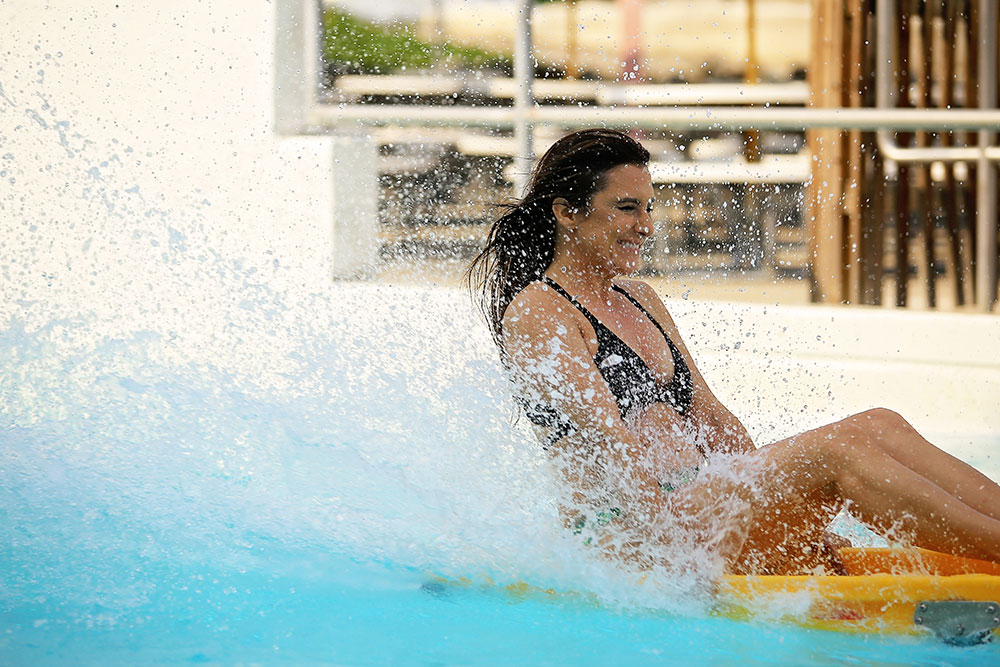 Woman sliding at Screaming Mimi attraction, Water World