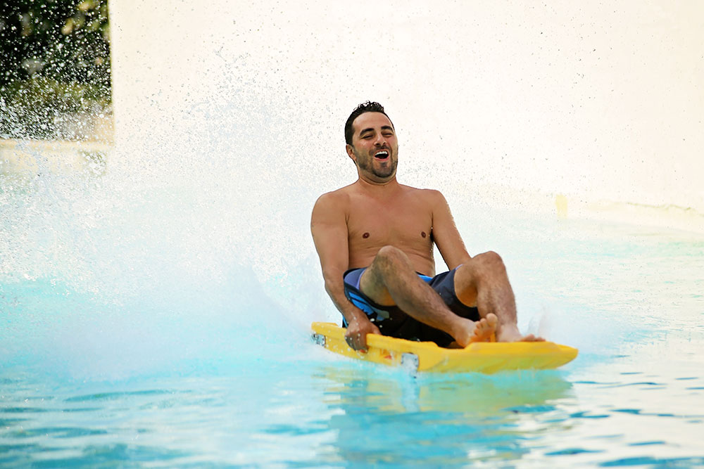 Man sliding at Screaming Mimi attraction, Water World