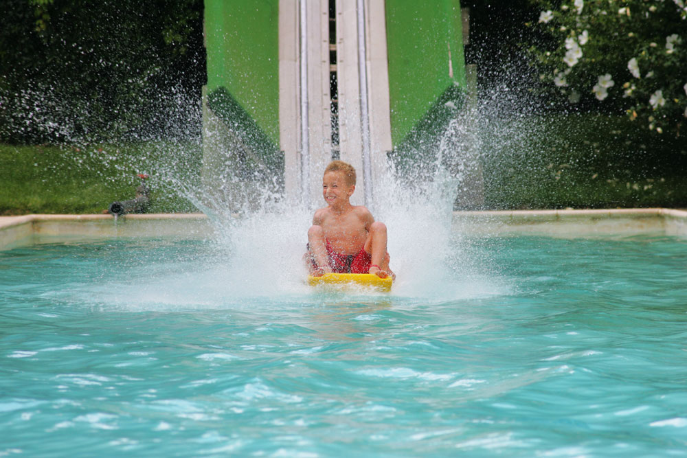Boy sliding at Screaming Mimi attraction, Water World