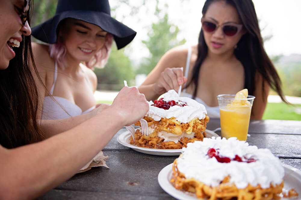 Young Ladies Eating Dessert