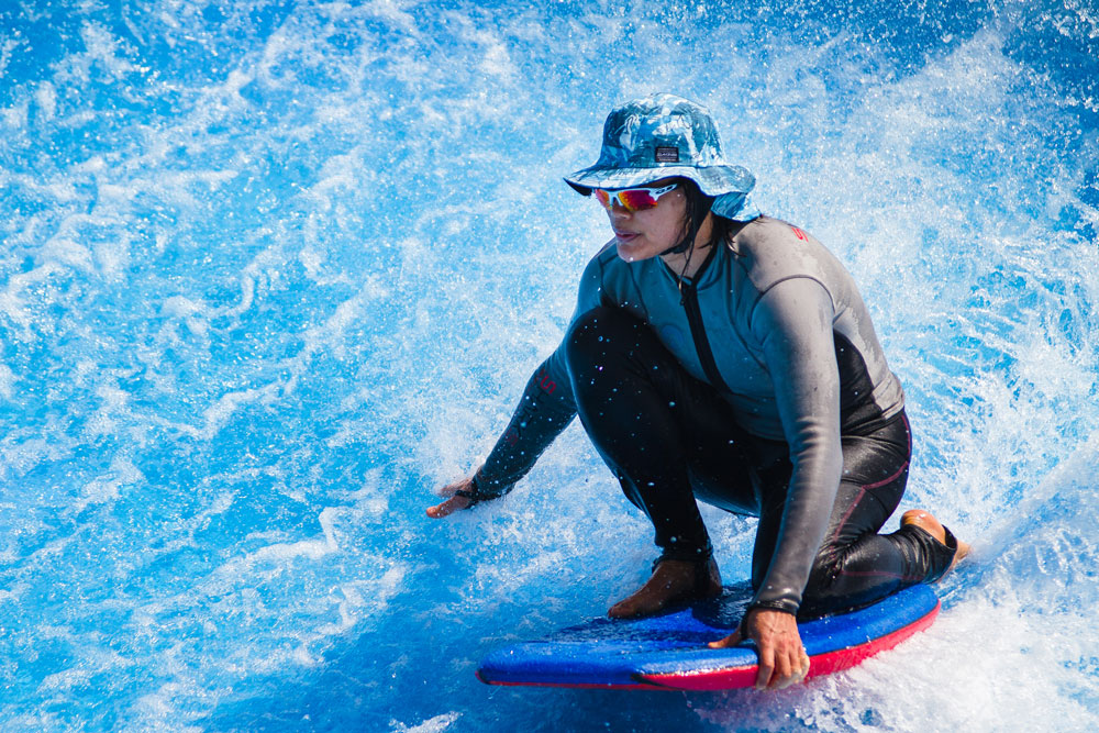 Woman on water board at The Wave, Water World