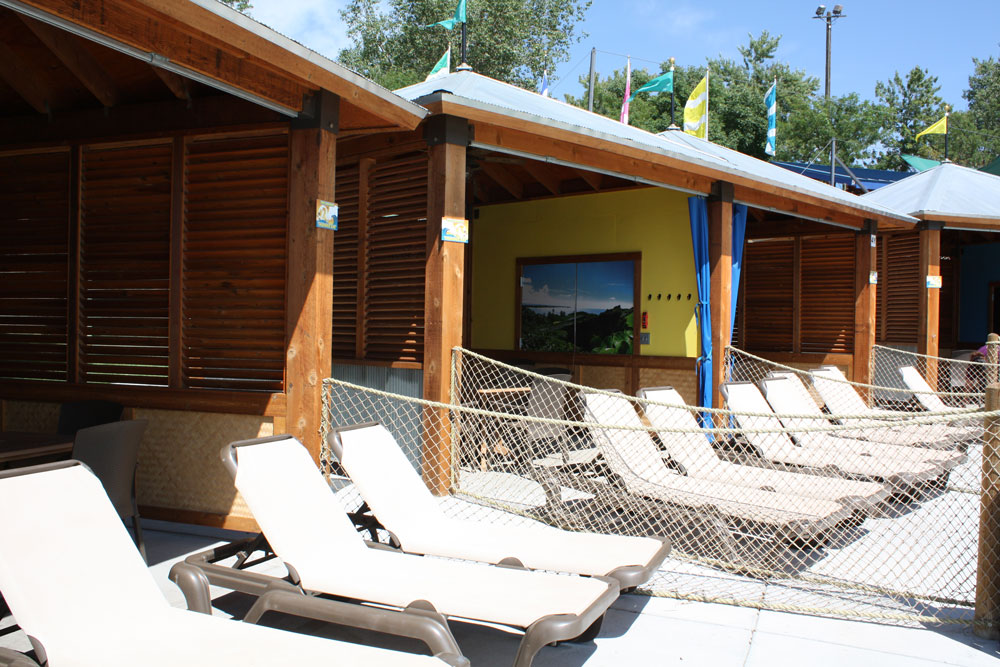 Outside view of the cabanas at Thunder Bay with sun chairs