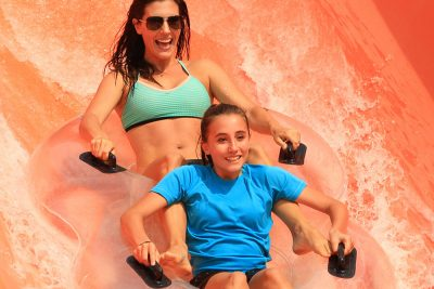 Mother and daughter sliding at Double Dare attraction, Water World