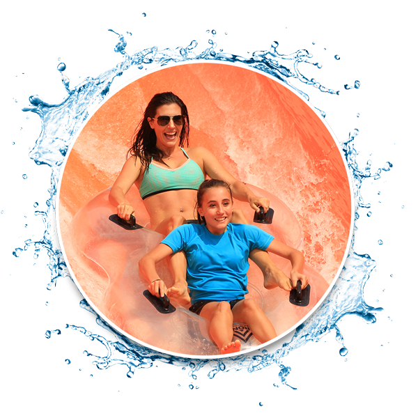 mother and daughter sliding on water tube